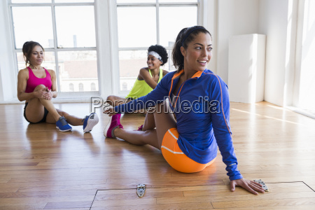 women stretching in room
