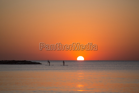 paddleboarders at sunset tel aviv israel