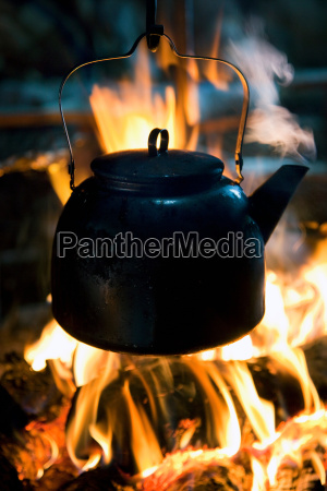 a kettle boils on top of