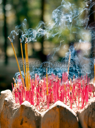 incense sticks given as offerings burn