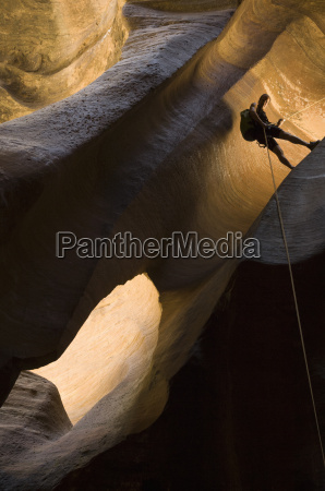 man hiking great cathedral rappell in