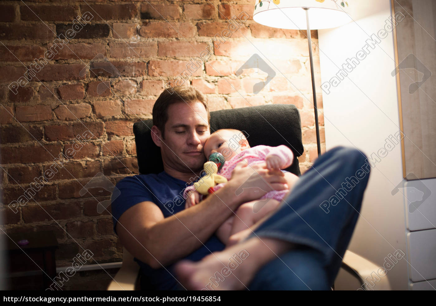 father, holding, baby, daughter, in, armchair - 19456854