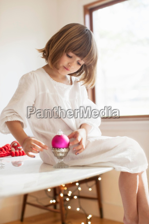girl on table playing with christmas
