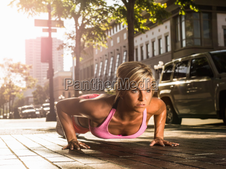 young woman doing push up on