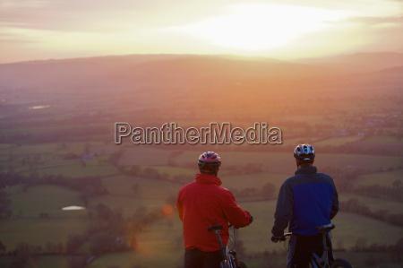two mountain bikers viewing scene