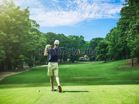 rear view of young male golfer