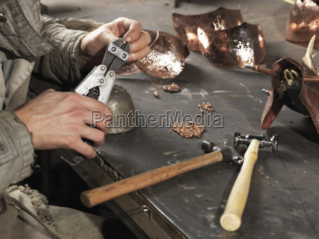 cropped image of blacksmiths hands working