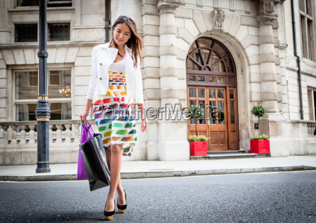 young woman walking in london street