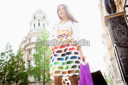 young woman standing in london street