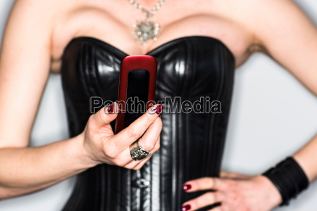 dominatrix in basque using cell phone