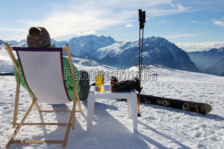 skier relaxing with a beer