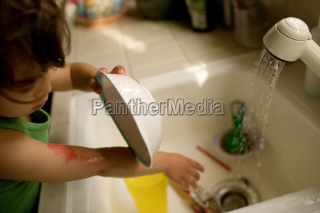 toddler girl washing up