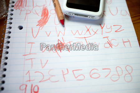 childs writing on notepad