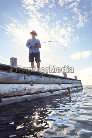 senior man standing on pier with