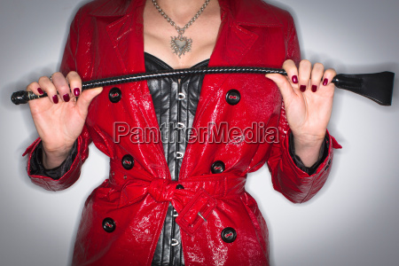 dominatrix in red pvc jacket basque