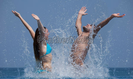 couple playing together in water
