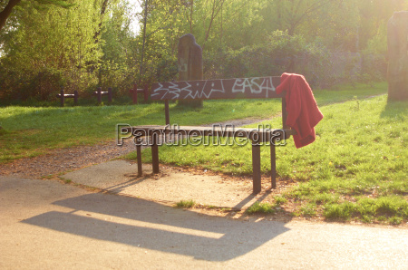 lost jacket on a park bench