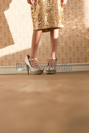 girl wearing her mothers high heels