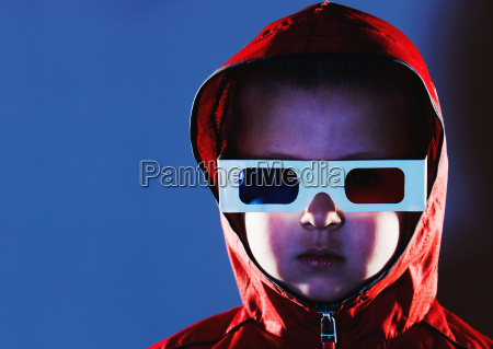 young boy wearing 3d glasses and