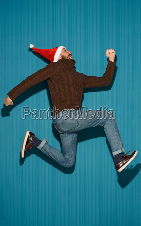the running christmas man wearing a