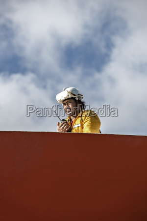 worker using walkie talkie whilst mooring