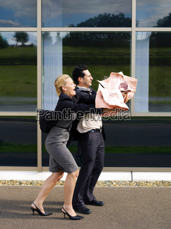 couple struggling with newspaper