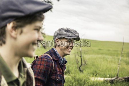 boy and man wearing flat caps
