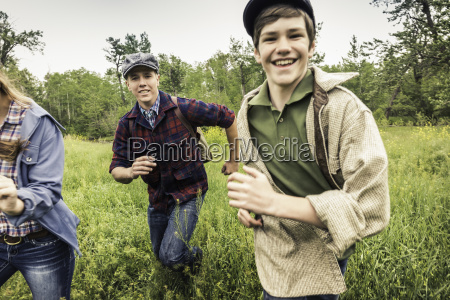 young adults and teen boy wearing