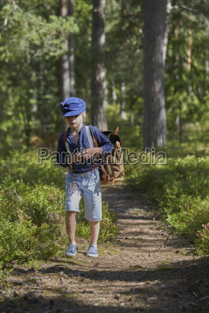 boy with rucksack dressed in retro