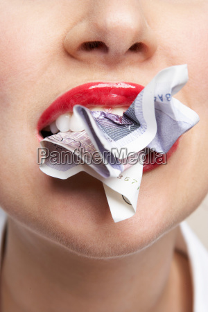 woman eating a bank note