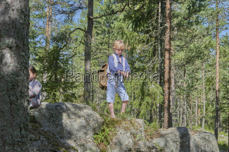 boy wearing retro clothes on rock