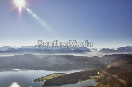 high angle view of sunlit mountains