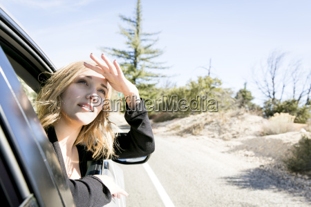 young woman poking head out of