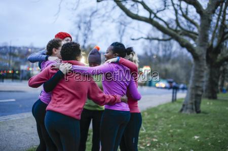 six female adult runners sharing motivation