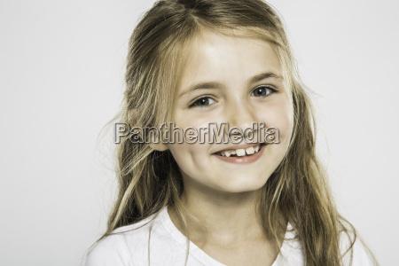 studio portrait of happy girl with