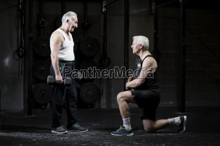 senior men preparing to weightlift in