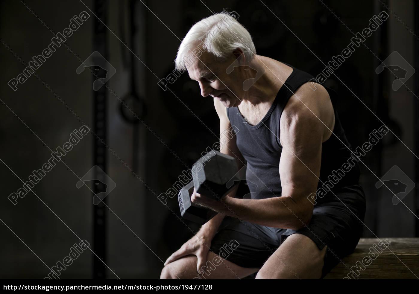 senior, man, sitting, doing, bicep, curls - 19477128