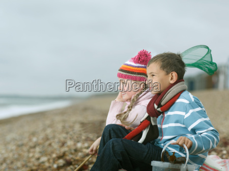 boy and girl at beach looking