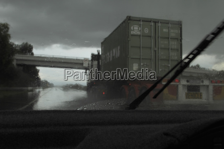 shipping truck viewed from car