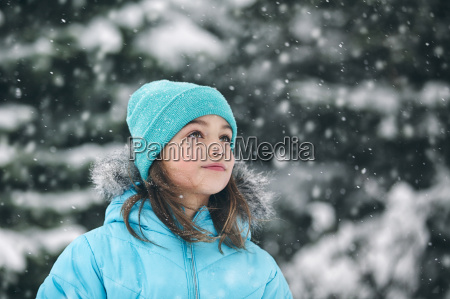 girl wearing knit hat looking away