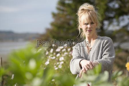 portrait of woman in organic garden