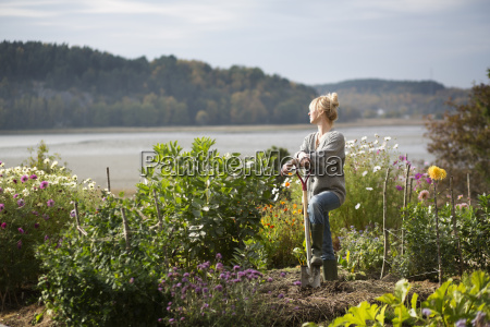 woman looking out from organic garden