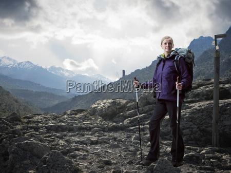 hiker walking on rocky landscape