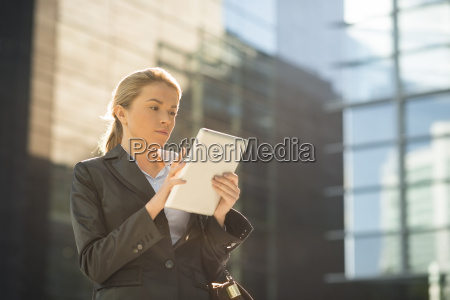 young city businesswoman using touchscreen on