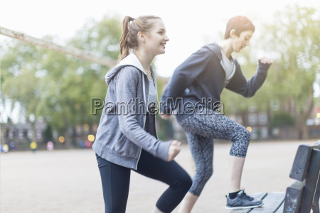 side view of young women exercising