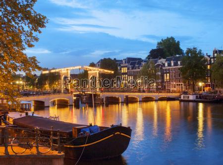 the skinny bridge illuminated at dusk
