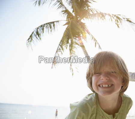 portrait of boy with toothy grin