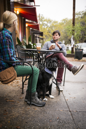 couple with dog having coffee at