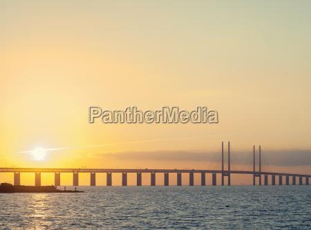 sunset view of oresund bridge between