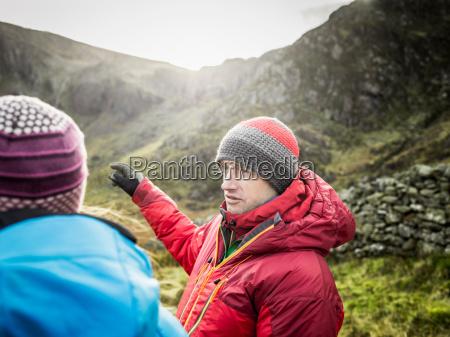couple hiking in rocky landscape